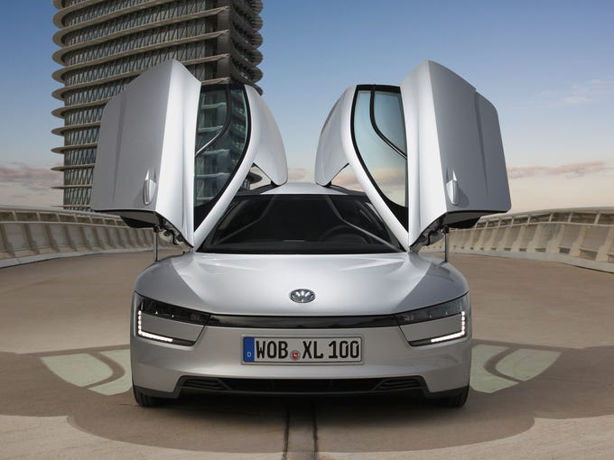 Volkswagen said Feb. 21 that it is putting super fuel-efficient XL1 gasoline-electric hybrid into production. It has gull-wing doors, which are becoming popular.
