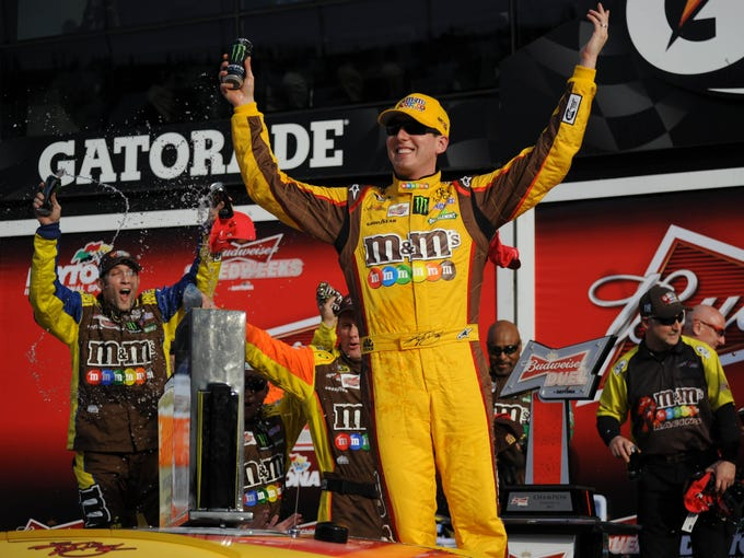 Kyle Busch celebrates in victory lane after winning the Budweiser Duel race 2 Thursday. Busch will start in the second row alongside Kevin Harvick in Sunday's Daytona 500.