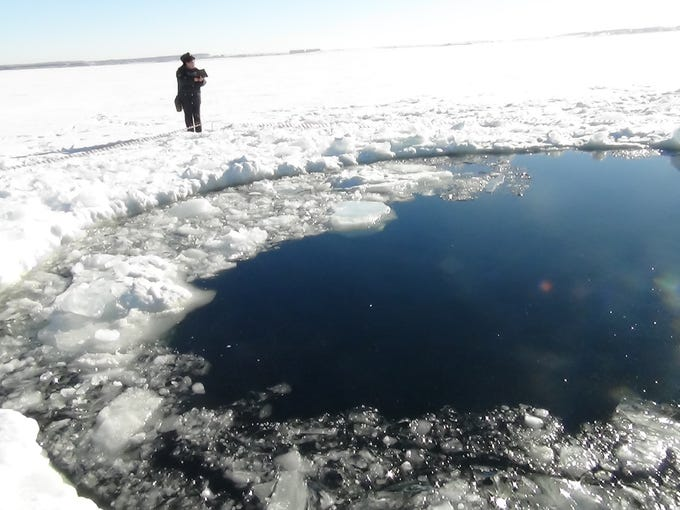 A circular hole in the ice of Chebarkul Lake where a meteor reportedly struck the lake near Chelyabinsk, about 1500 kilometers (930 miles) east of Moscow,  Russia,  Feb. 15. A  meteor streaked across the sky and exploded over Russiaís Ural Mountains with the power of an atomic bomb last Friday, its sonic blasts shattering countless windows and injuring nearly 1,000 people.
