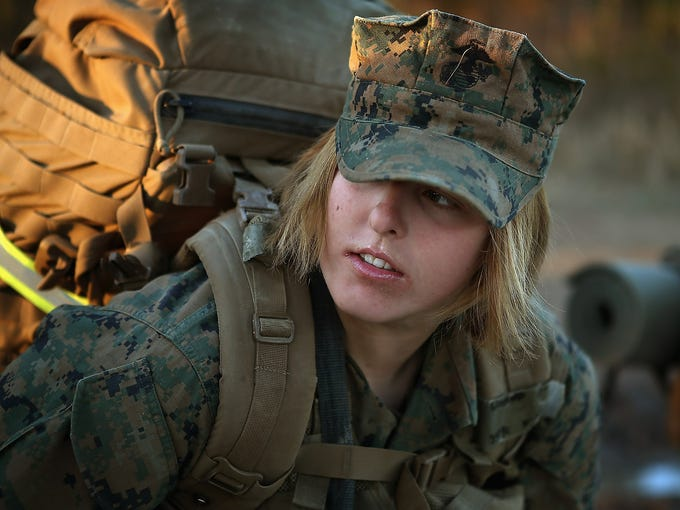 U.S. Marine Pfc. Schevlle Woodard prepares to leave for a 9-mile night march on Feb. 21 at Camp Lejeune, N.C. Since 1997, all enlisted female Marines, after graduation from boot camp, are required to complete 29 days of basic infantry and combat skills at the Marine Combat Training course.