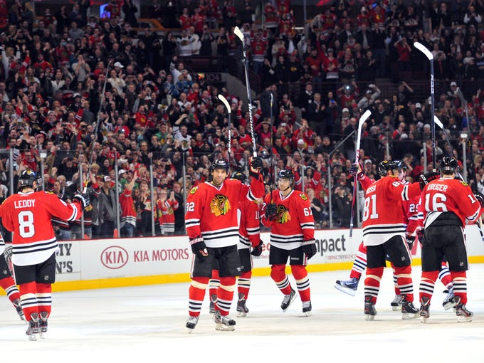 The Chicago Blackhawks set an NHL record with points in their first 24 games (21-0-3), or half the lockout-shortened season. A game-by-game look at the streak, which ended Friday: