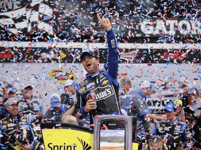 Jimmie Johnson celebrates his second Daytona 500 win in victory lane Sunday.