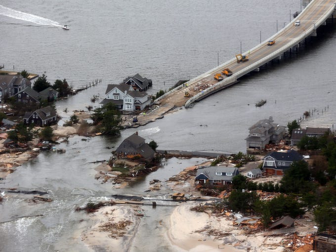 <b></b><b>Mantoloking, N.J.:</b> An aerial view of storm damage Oct. 31 over the Atlantic Coast at the base of the Mantoloking Bridge.