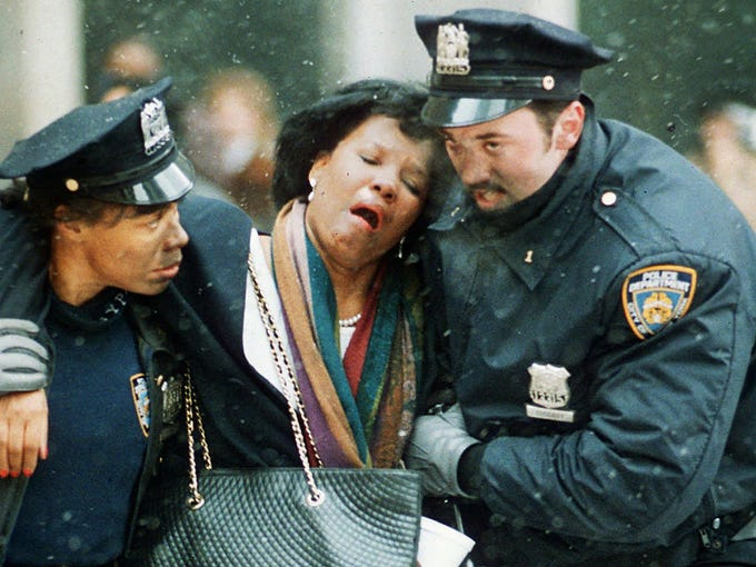 Police officers help an injured woman after a bombing at the World Trade Center on Feb. 26, 1993, in New York City. Six people were killed when terrorists blew up a vehicle packed with explosives in an underground parking garage under one of the towers.
