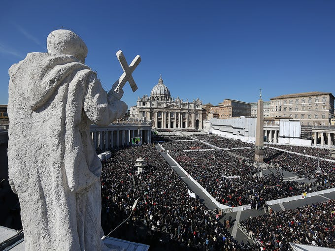 """Thousands gather in St. Peter's Square as Pope Benedict XVI arrives for his last weekly audience on Feb. 27 at the Vatican. The pope recalled moments of """"joy and light"""" during his papacy but also times of great difficulty in an emotional, final general audience in St. Peter's Square before retiring."""