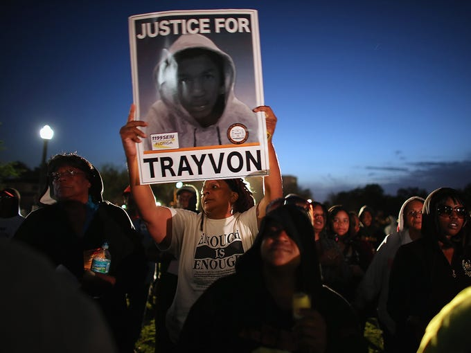 People attend a vigil marking the one-year anniversary of the death of Trayvon Martin at Fort Mellon Park on Feb. 26 in Sanford, Fla.Martin was allegedly shot and killed by George Zimmerman, a neighborhood watch member, on Feb. 26, 2012, at The Retreat at Twin Lakes in Sanford, Fla. Zimmerman's trial on a second-degree murder charge is scheduled for June 10.