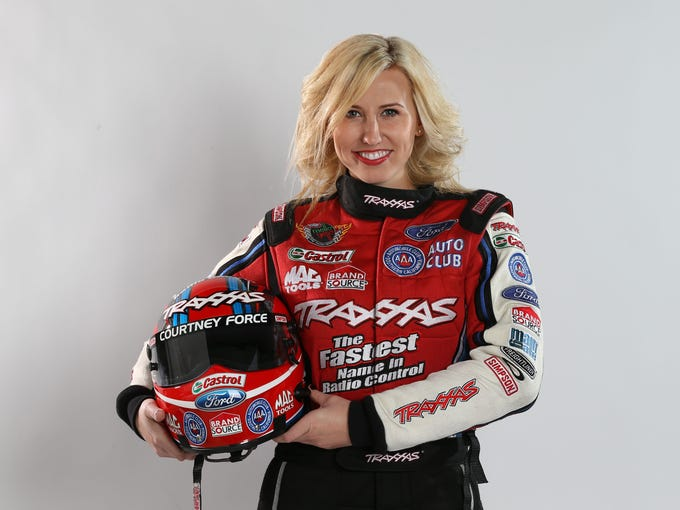 Courtney Force, 26, followed in her legendary father John Force's footsteps, becoming one of the top Funny Car drivers in the NHRA.