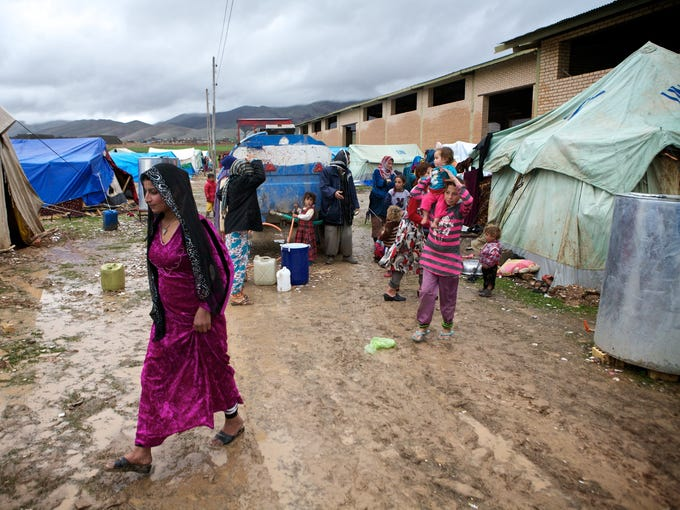 Heavy rain has created waterlogged conditions in Arbat refugee camp in Iraqi Kurdistan. Syrian refugees, mostly ethnic Kurds, have been arriving steadily in the Kurdish region of Iraq since the beginning of the conflict in Syria.
