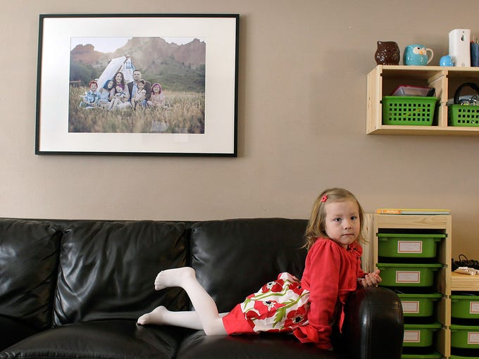 Coy Mathis sits on a couch at her home on Feb. 25 in Fountain, Colo. Coy has been diagnosed with Gender Identity Disorder. Biologically, the 6-year-old is a boy, but to his parents, three sisters and brother, and others, Coy identifies as a girl.
