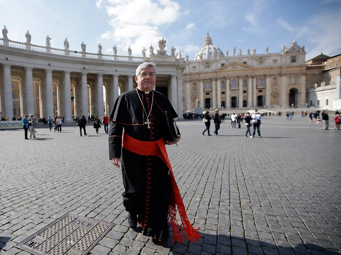 Canadian Cardinal Thomas Christopher Collins walks across St. Peter's Square on March 4 at the Vatican. Cardinals from around the world gathered for their first round of meetings before a conclave to elect the next pope.