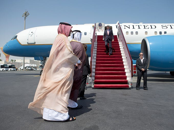 Qatari Chief of Protocol Abdullah Fakhroo, left, and Qatari Ambassador to the U.S. Mohamed al-Rumaihi prepare to greet Secretary of State John Kerry on March 5 at Doha International Airport in Doha, Qatar. Kerry is visiting the final country on his first official visit overseas as secretary of State.