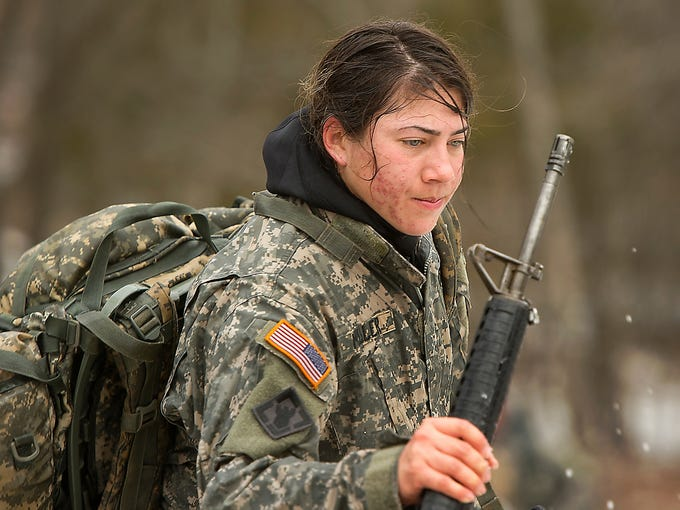 U.S. Army 1st Lt. Ashley Miller collects her equipment after a timed swim at Lake of the Ozarks on Feb. 25 near Fort Leonard Wood, Mo. Miller is the only female student among 36 students participating in the U.S. Army's Sapper Leadership Course, a physically tough school that trains combat engineers.