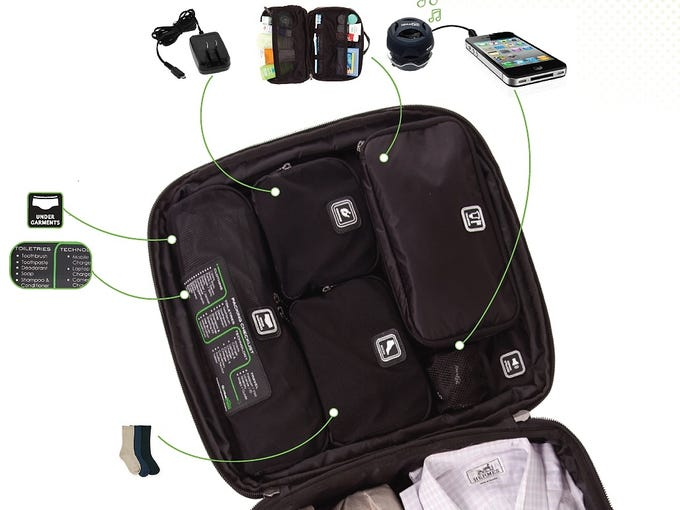 """Genius Packer 22"""""""" Carry On: Ideal for travelers who unapologetically admit to obsessive-compulsive disorder when it comes to packing, this hyper-organized bag has compartments for socks, underwear and electronic gadgets, including a mobile charger and mini speakers (both $28)."""