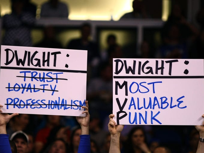 Orlando Magic fans hold up signs against Los Angeles Lakers center Dwight Howard (not pictured) during the first quarter at Amway Center.