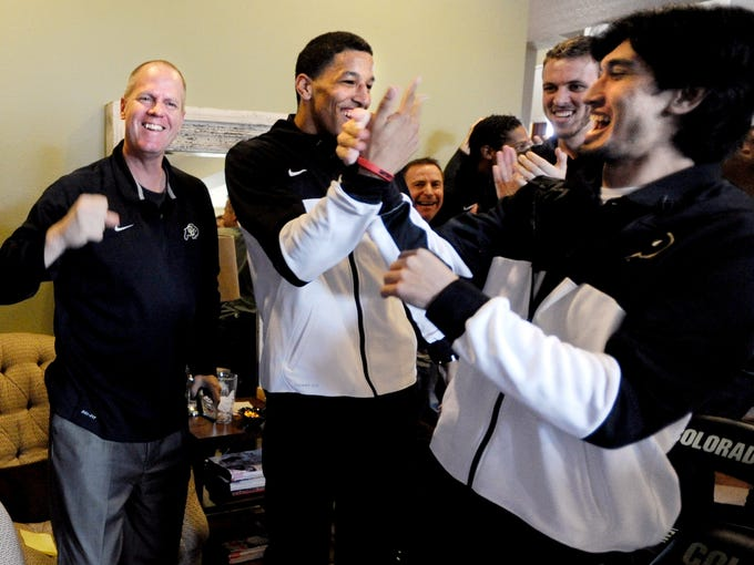 Colorado coach Tad Boyle, left, and his Buffaloes were all smiles when they were announced as the No. 10 seed in the East Regional. Colorado will play Illinois in the second round on Friday in Austin, Texas.