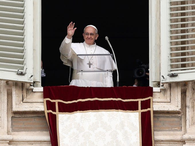 Pope Francis gives his first Angelus blessing to the faithful from the window of his private residence on March 17 in Vatican City. The Vatican is preparing for the inauguration of Pope Francis on March 19 in St. Peter's Square.