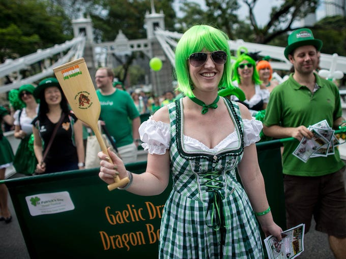 People participate in the St. Patrick's Day parade at Boat Quay on March 17 in Singapore.  Singapore's Irish community gathered at Boat Quay for a three-day-long festival featuring street performances, buskers and Irish food and drink.