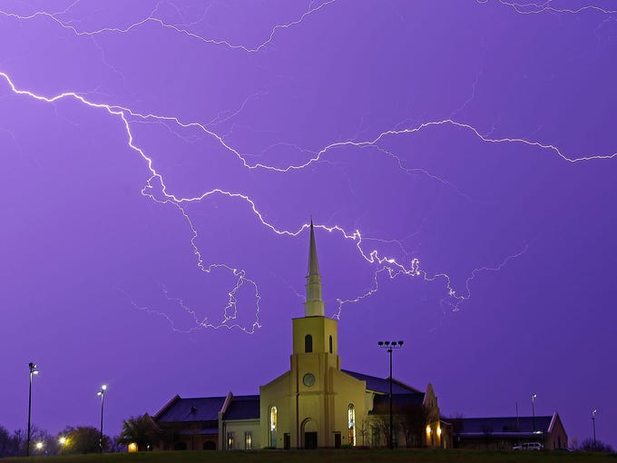 Lightning streaks across the sky behind the Young Meadows Presbyterian Church on March 18 in Montgomery, Ala.