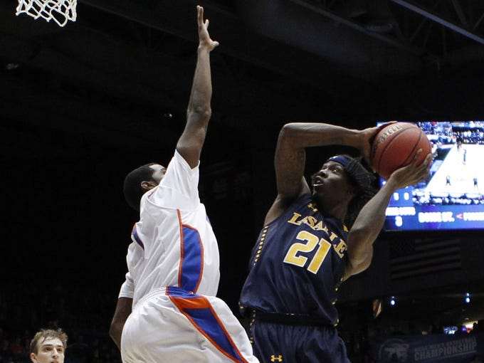 La Salle Explorers guard Tyrone Garland shoots against the Boise State Broncos guard Mikey Thompson in the second half during the first round at University of Dayton Arena.