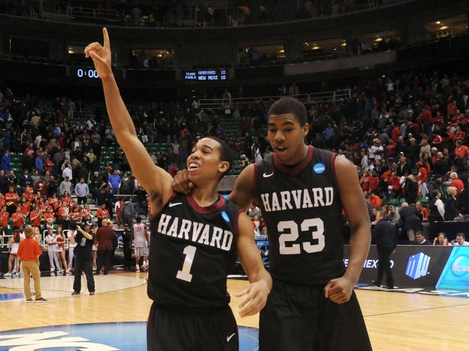West Regional (Salt Lake City): Harvard guard Siyani Chambers celebrates the school's first NCAA tournament win after the 14th-seeded Crimson defeated No. 3 seed New Mexico.