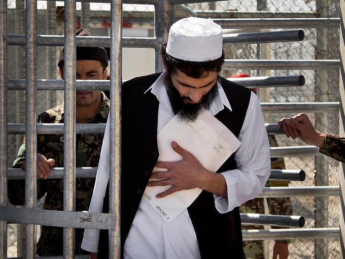 An Afghan inmate clutches his release papers as he leaves the Parwan Detention Facility after the U.S. military relinquished control to Afghan authorities on March 25 in Bagram. Control of the facility was a major issue between U.S. authorities and Afghan President Hamid Karzai, who viewed foreign administration of the facility as an affront to national sovereignty.
