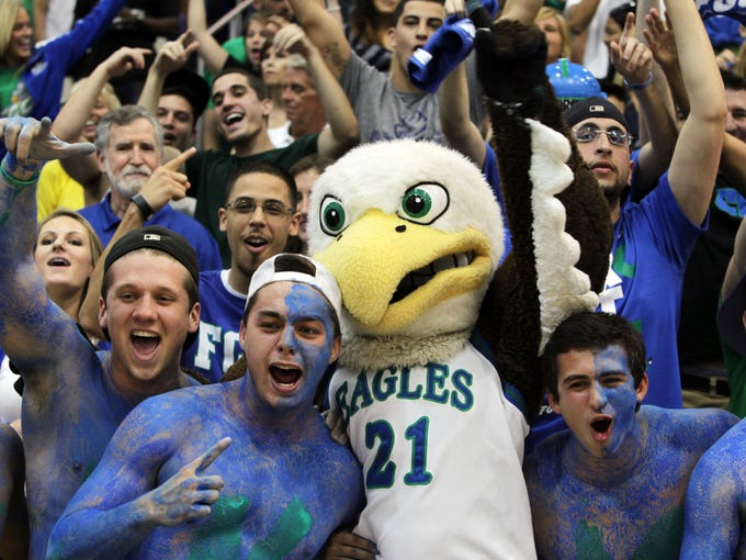 From left, Kristian Avellanet, Nick Schilson, Florida Gulf Coast University mascot Azul, Nick Mucerino and Dario Nachef celebrate the Eagles' trip to the Sweet 16 during a pep rally at Alico Arena in Fort Myers, Fla.
