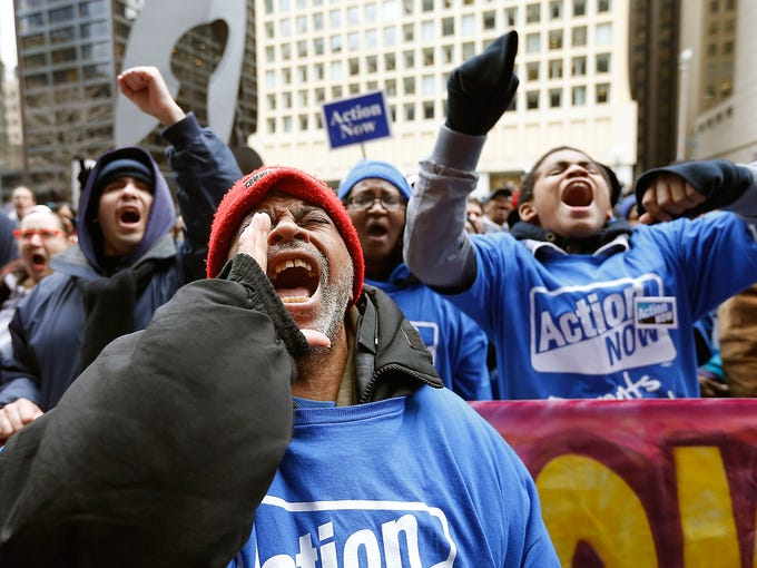 Demonstrators protest March 27 against a plan to close 54 public schools in Chicago. Mayor Rahm Emanuel and schools CEO Barbara Byrd-Bennett say closing underutilized buildings will allow the district to move students to higher quality schools and help trim a $1 billion budget shortfall.