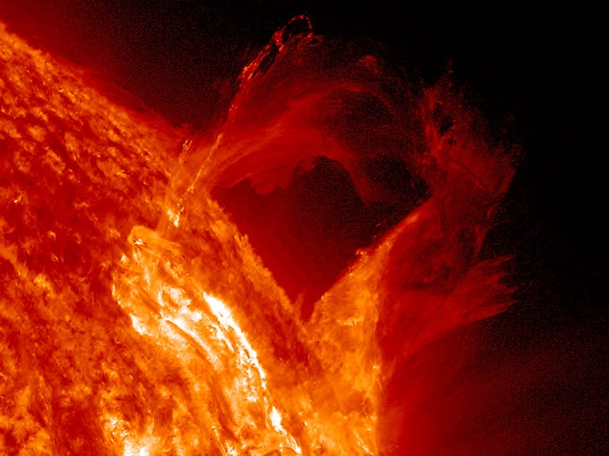 A March 16 solar prominence on the sun begins to bow out and break apart. The four-hour sequence was captured in extreme ultraviolet light.