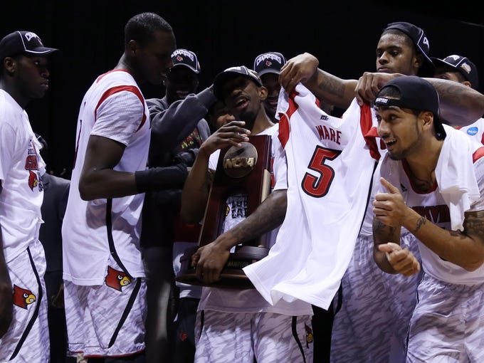 The Louisville Cardinals  celebrate winning the Midwest Regional, dispatching Duke 85-63 on March 31.