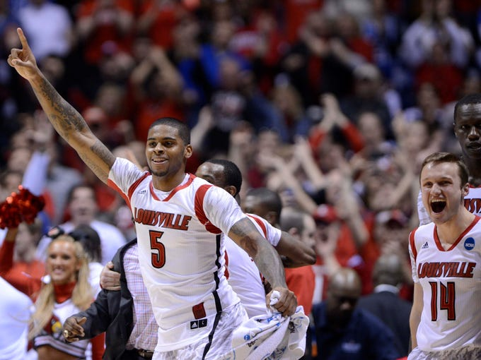 Louisville Cardinals forward Chane Behanan (wearing the #5 jersey of injured teammate Kevin Ware) celebrates after the Midwest regional of the 2013 NCAA tournament against the Duke Blue Devils at Lucas Oil Stadium.  Louisville won 85-63.