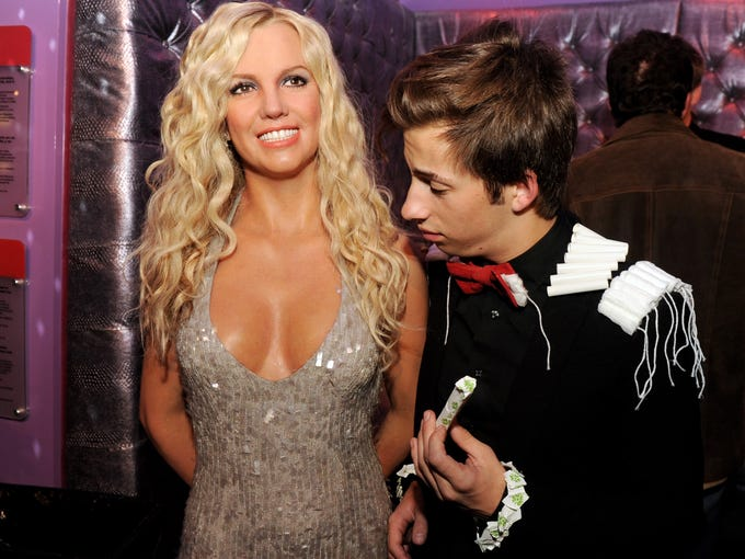 Dude, they're wax. Actor Jimmy Bennett may think that he's getting an eyeful but it's just  a wax figure of Britney Spears at Madame Tussauds Hollywood. There are 15 Madame Tussauds around the world.
