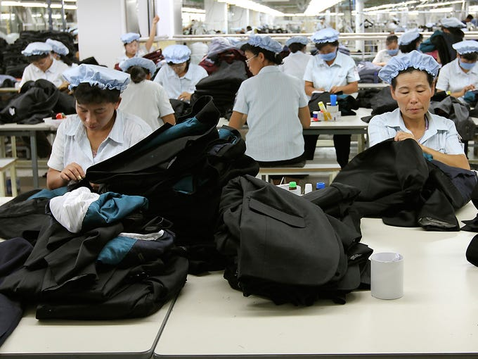 North Korean workers assemble clothing at the South Korean-run ShinWon garment factory at the Kaesong industrial complex on Sept. 21, 2012, in Kaesong, North Korea. North Korea barred South Korean managers and vehicles from entering the industrial park on April 3, a day after announcing it will restart its nuclear program.