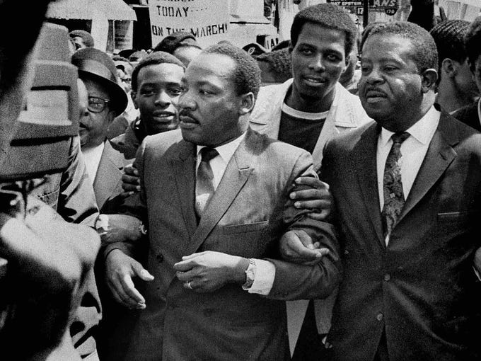 Martin Luther King Jr., center, and Rev. Ralph Abernathy, right, lead a march on behalf of striking sanitation workers on March 28, 1968, in Memphis. Forty-five years ago, King was shot and killed by James Earl Ray at the Lorraine Motel on April 4 while supporting the striking workers.