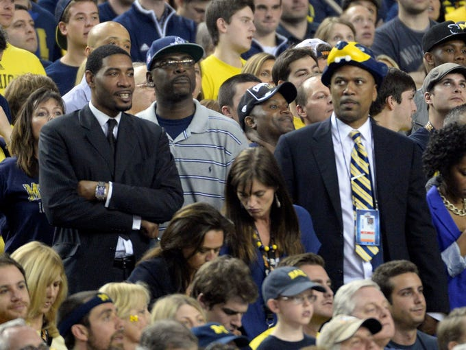 From left, Jimmy King, Ray Jackson and Jalen Rose take in the first half of the national championship game in Atlanta.