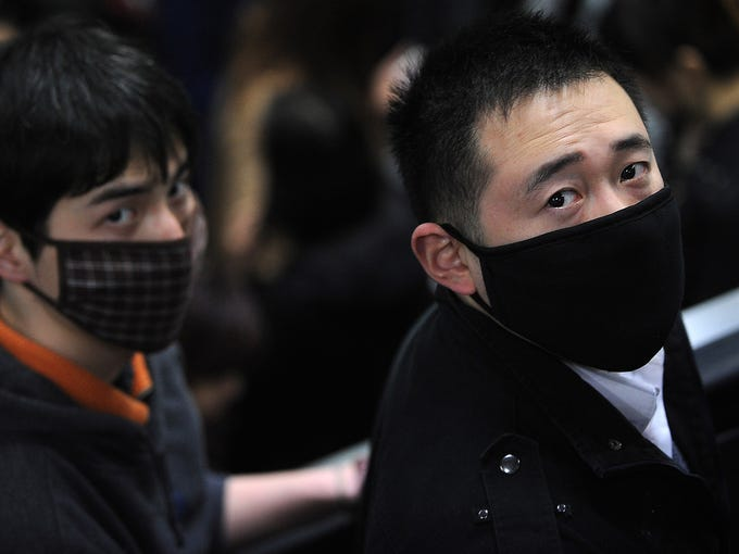 People wear masks to protect themselves from the bird flu as they ride a subway train April 9 in Shanghai, China. Twenty-four people have been infected and seven of them have died after contracting the H7N9 strain of bird flu. However, there is no evidence of human-to-human transmission.