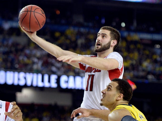 Luke Hancock came up big again, leading the Louisville Cardinals with 22 points, hitting all five of his 3-pointer attempts, in a 82-76 national championship win over Michigan. He became the first bench player in history to win the Final Four's Most Outstanding Player award.