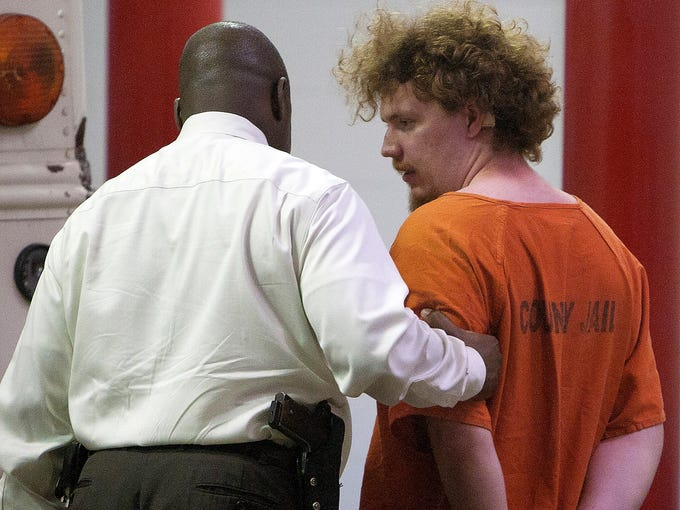 Dylan Quick, right, a suspect in the multiple stabbings on the Lone Star Cy-Fair Campus, is escorted by a Harris County Sherrif's Office investigator after being questioned on April 9 in Houston.  Quick, a student at the school, allegedly went on a building-to-building stabbing attack at the Texas community college.