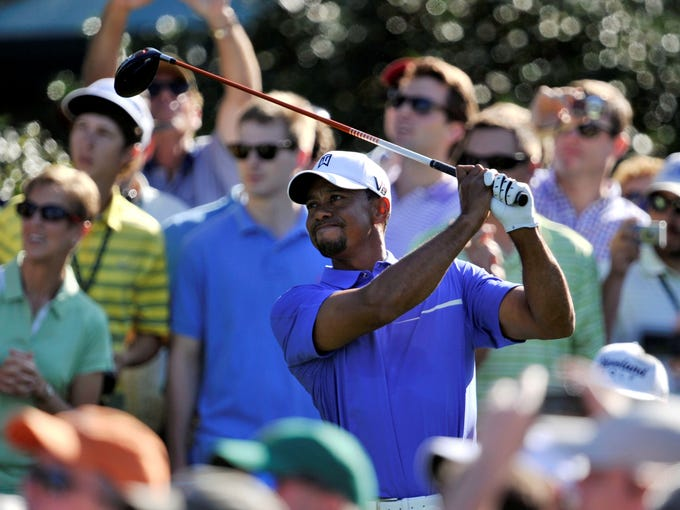 Tiger Woods hits a tee shot on the 15th hole during a practice round.