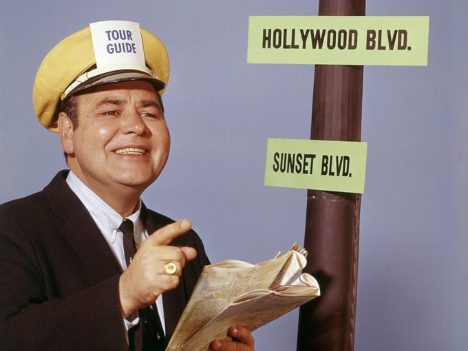 Comedian Jonathan Winters, known for his improvisational skills, got his start in show business by winning a talent contest. This led to a children's TV show in Dayton in 1950.  He made 10 Grammy-nominated comedy recordings and won once.