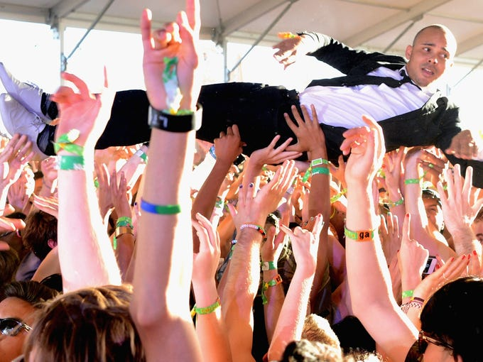 DJ Walshy Fire of Major Lazer crowd surfs during a performance on April 13 at the 2013 Coachella Valley Music & Arts Festival in Indio, Calif.