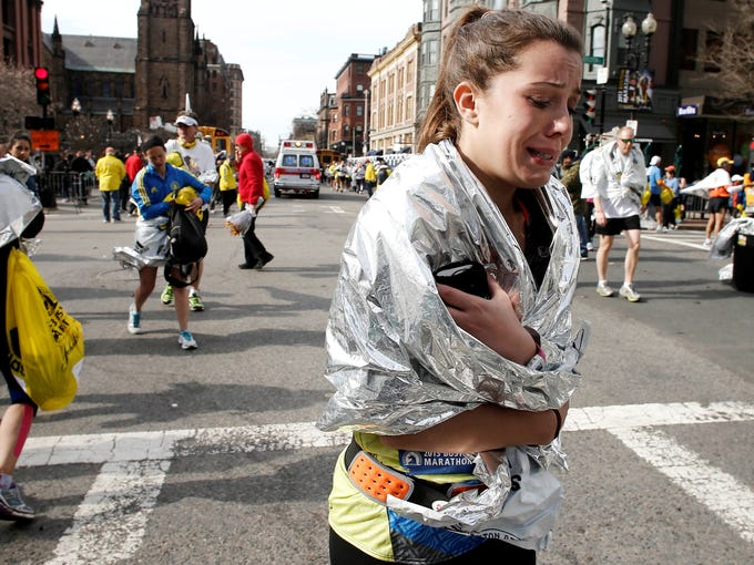 An unidentified Boston Marathon runner leaves the course crying near Copley Square following an explosion in Boston on Monday. Some of the images in the gallery are graphic.