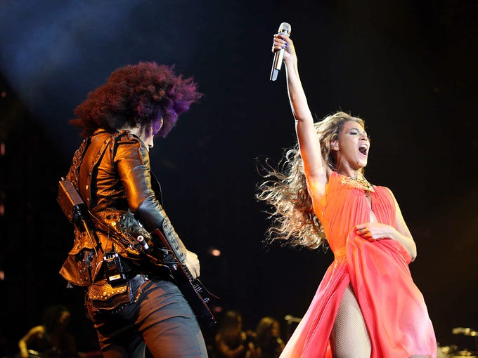 Mrs. Carter is ready to rock, and she's doing it in style, of course. Beyoncé kicked off her 'Mrs. Carter Show' world tour Monday in Belgrade, Serbia, where she wore an array of designer duds. Here, she wears a flowing crimson gown by designer Alon Livne as she gives the crowd a roar along with guitarist Bibi.