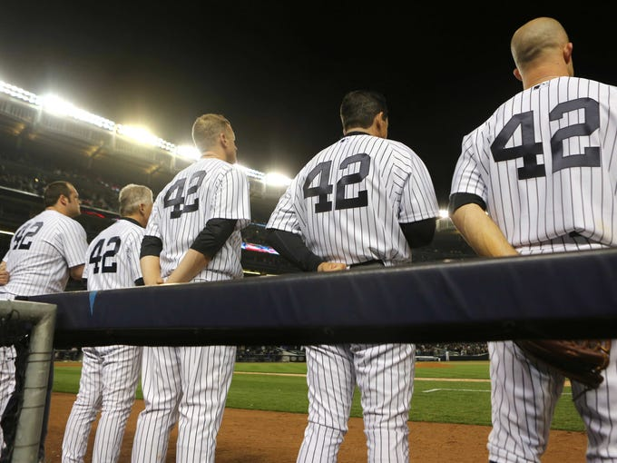 New York Yankees players line up wearing No. 42 to honor Jackie Robinson before the game against the Arizona Diamondbacks at Yankee Stadium.