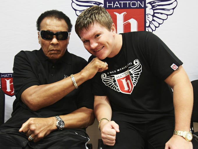 Boxing great Muhammad Ali delivers a knockout blow to Ricky Hatton in a guest appearance at Hatton's gym in Manchester, England, Wednesday, Aug. 26, 2009.