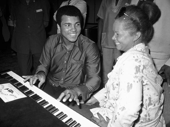 Muhammad Ali plays a few notes on the piano while visiting black American artists that perform in the Zaire 74 music festival in Kinshasa, Zaire, Sept. 22, 1974. At right is singer Etta James.