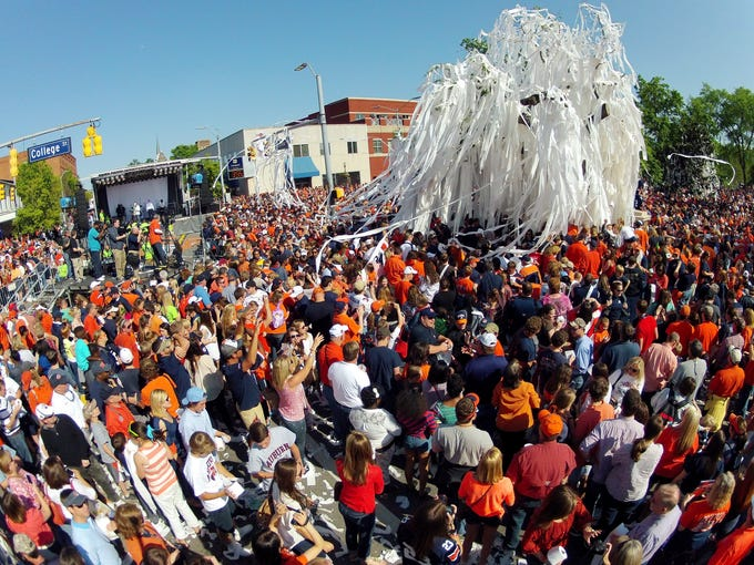 Thousands of Auburn fans roll the Toomer's Corner trees for the last time following Auburn A-Day spring game at Jordan-Hare Stadium on April 20, 2013.