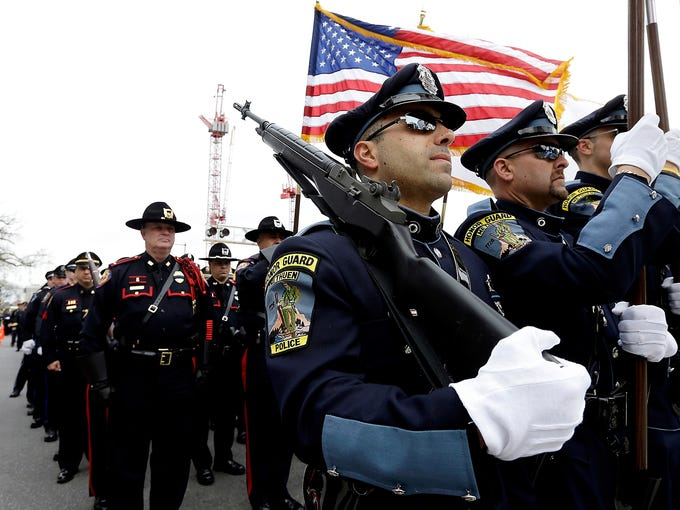 A police honor guard leads a column of law enforcement officials during a memorial service for slain Massachusetts Institute of Technology police officer Sean Collier on April 24 in Cambridge. Collier was shot and killed April 19 on the MIT campus allegedly by the Boston Marathon bombing suspects.