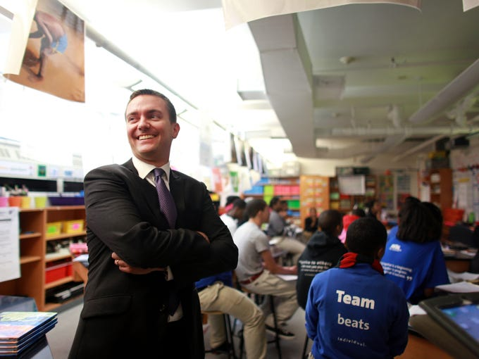 "In 2002, educator Ryan Hill opened his dream school with all of 80 students, four teachers and one office manager. ""I was there till midnight every single night,"" he said. ""It was really hard."" Here, Hill observes an eighth-grade science class at The Rise Academy in Newark, N.J."