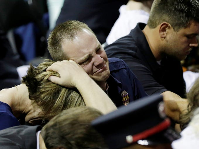 West Emergency Medical Technician Bryce Reed, center, attends a memorial service in Waco, Texas, for his brother, Cyrus Reed, and other victims of the fertilizer plant explosion in West, Texas.