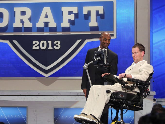 Former New Orleans Saints safety Steve Gleason announces a draft pick during the third round of the NFL draft.